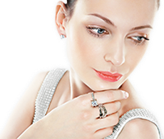 Beautiful Woman Looking at a Pair of Wonderful Elegant Diamond Earrings